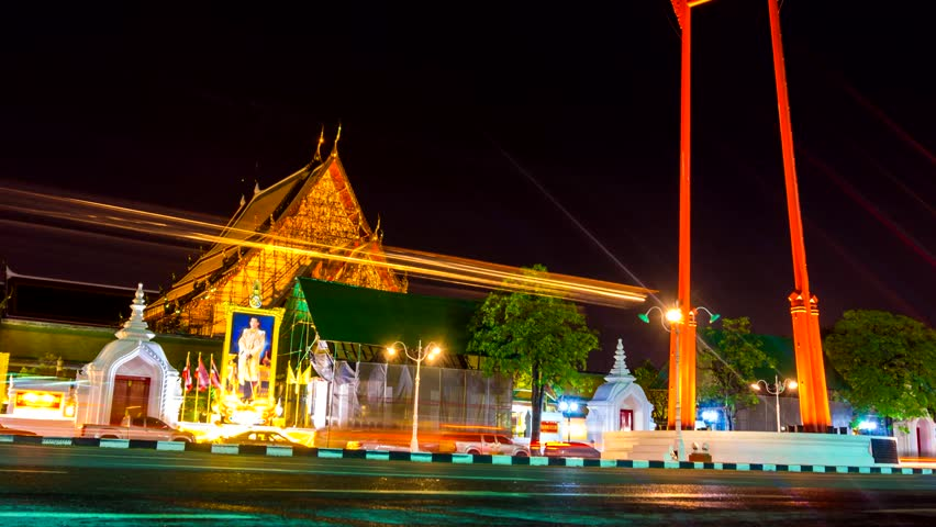 Night transport time lapse of Giant Swing Sao Ching Cha with buddha temple, Bangkok Thailand