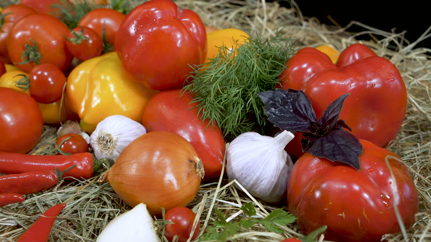 Different kinds of peppers and tomatoes. Combination of red and yellow peppers with tomatoes