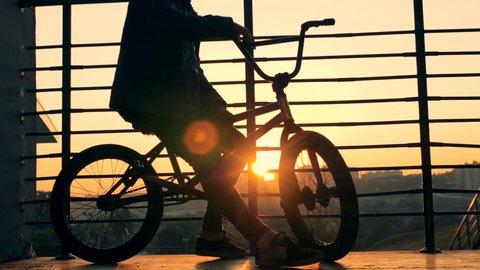 A rider on a BMX bike, close up.