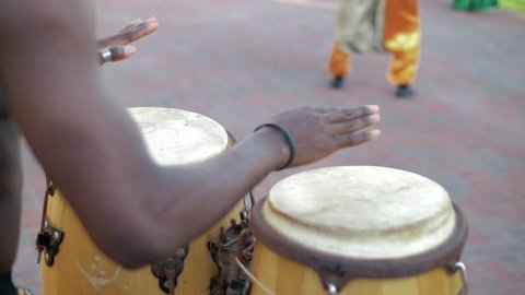 Black African plays on ethnic bamboo drums