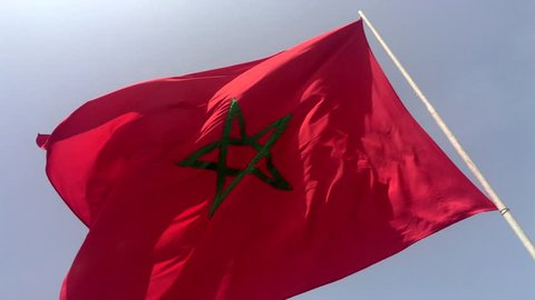 4K Moroccan waving flag on blue sky