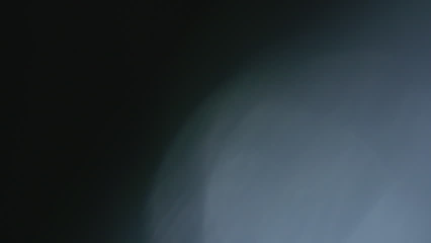 Soap bubble smileys in front of a black backround, slow motion