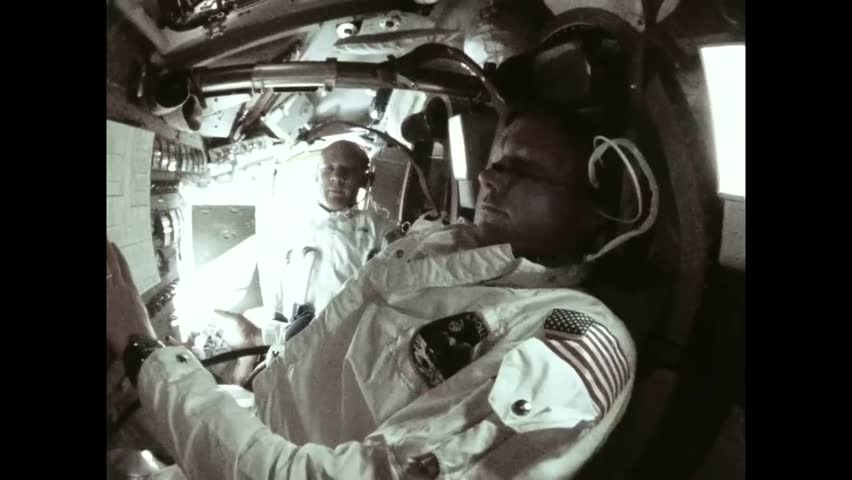 CIRCA 1969 - The Apollo 11 crew films each other on board, then the lunar surface as they fly over it.