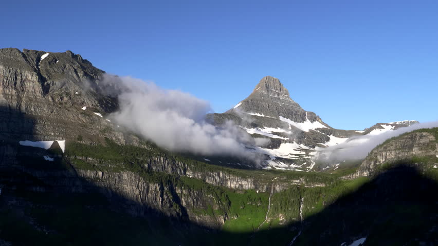 a summer morning view of mount clements and logan pass at glacier national park in montana, usa