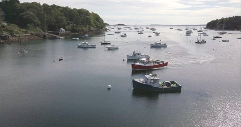 Rockport, Maine / United States - 09 22 2017: ROCKPORT, MAINE, SEPTEMBER 2017 - A red commercial boat coming in to port in Rockport Harbor.