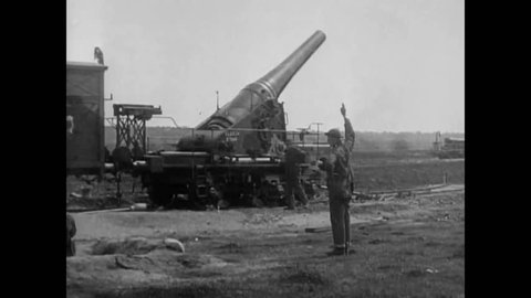CIRCA 1950s - Artillery pieces are fired in combat and a map is referenced and spent shells are shown in the Korean War.