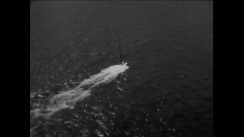 CIRCA 1972 - A US Navy vessel test launches a Poseidon missile (narrated in 1973).