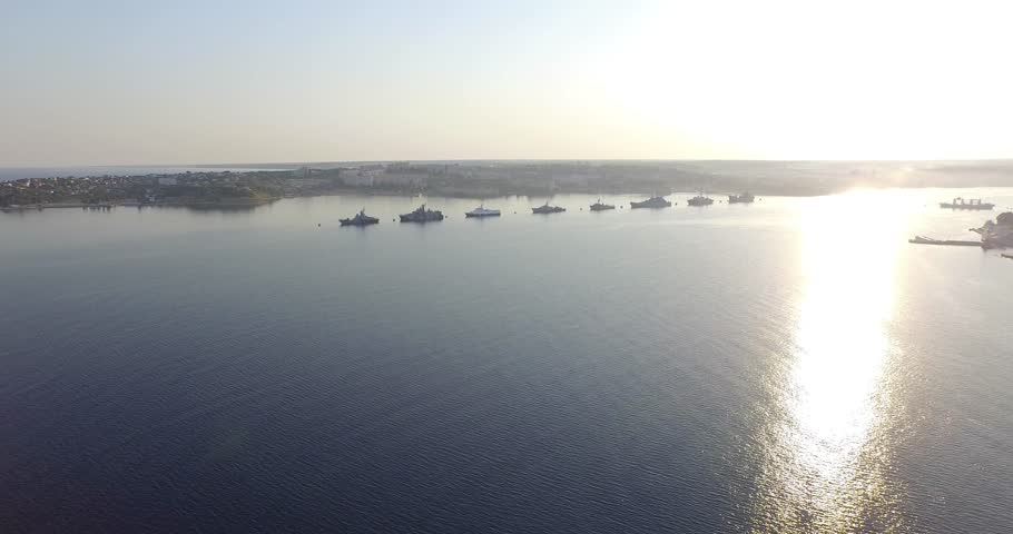 Shooting from the air of  Sevastopol bay, warships in the roads, Russian Navy Day 2015 | Shutterstock HD Video #1016330422