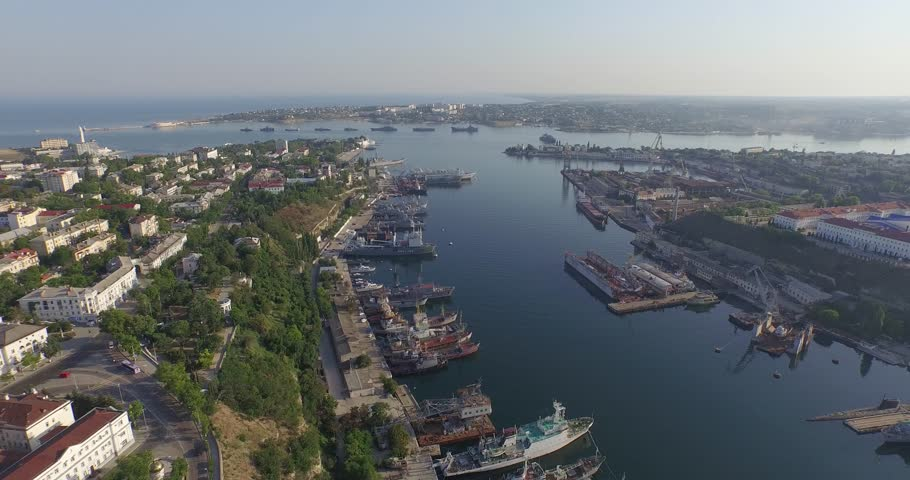 Shooting from the air of  Sevastopol bay, warships in the roads, Russian Navy Day 2015 | Shutterstock HD Video #1016331202