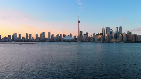 Aerial view of Toronto skyline including architectural landmark CN Tower at sunset in Toronto, Ontario, Canada.