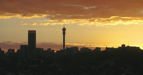 Magnificent Johannesburg / Joburg sunset with golden clouds and vista of the city.