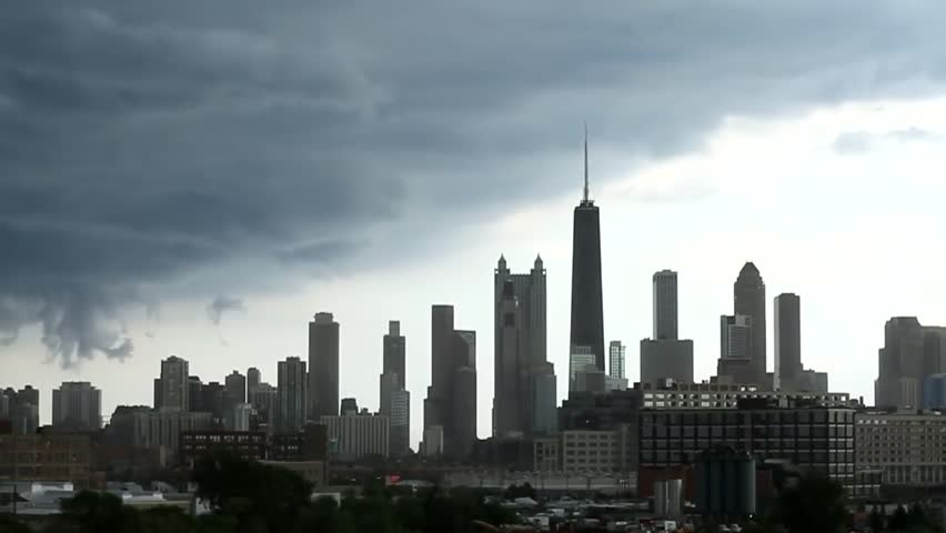 Chicago and the storm. Flying dense, gray clouds swiftly. Grow green trees. The wind blows vigorously. | Shutterstock HD Video #1016526772