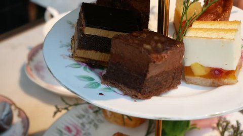 High tea tray with many sweet dessert -(Cake,Scone,Biscuit) for traditional english tea time