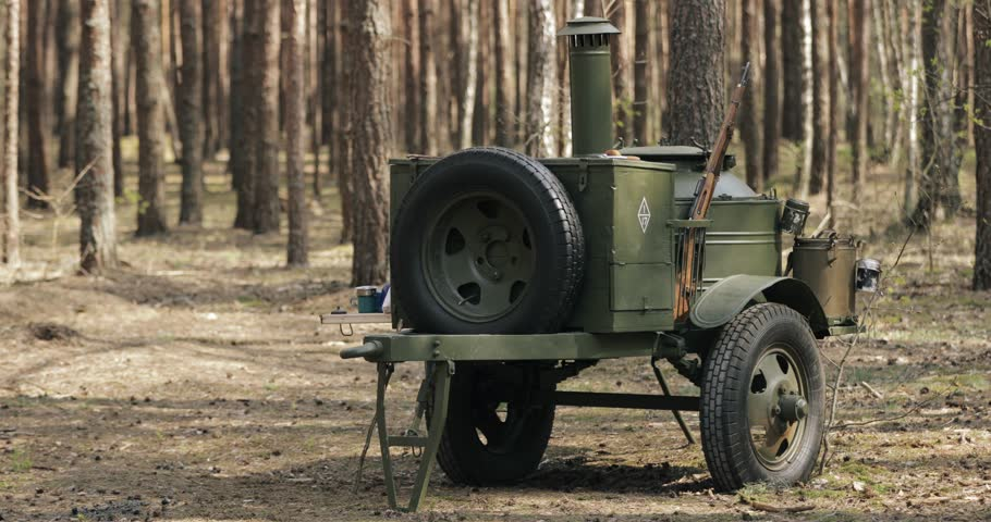 Russian Soviet World War II Field Kitchen In Forest. WWII Equipment Of Red Army. Mobile Kitchen, Mobile Canteens Or Food Truck