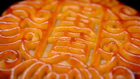 traditional style Chinese mooncake rotating the Chinese means yolk