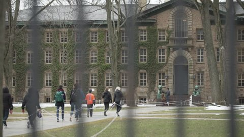 Princeton, NJ / United States - 02 07 2018: Winter 2017 - Tourist walking at Princeton University