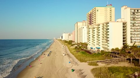 High view of Myrtle Beach with hotels , buildings and the ocean.