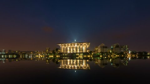 Time lapse of sunrise and clear sky at a mosque in Putrajaya, Malaysia with beautiful reflection in water from night to day. Move down motion timelapse. Prores Full HD 1080p.