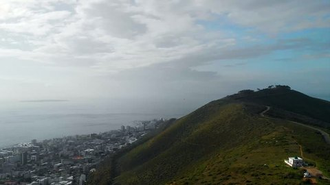 Graded Aerial shots in 60p establishing location at Table Mountain, Lion's Head Mountain in Capetown, South Africa.