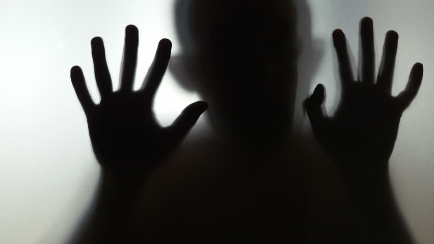 Scary human behind frosted glass in 4k slow motion 60fps   Shutterstock HD Video #1016683912