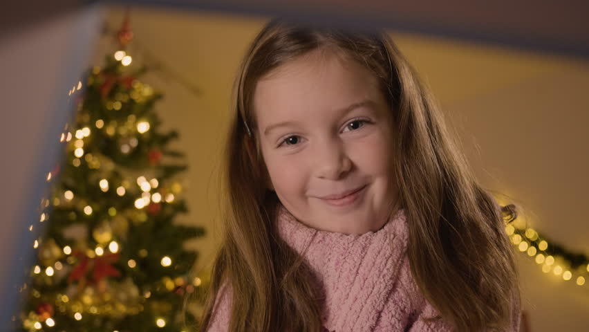 CU of a happy girl opening a Christmas gift, filmed from the inside of the present | Shutterstock HD Video #1016719522