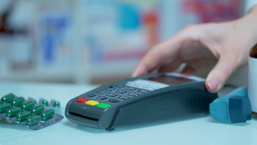Customer using mobile payment with apple watch at drugstore. Close up of male hand paying for drugs with nfc technology. Contactless payment with smartwatch | Shutterstock HD Video #1016726962