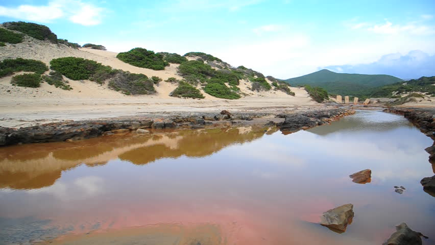 Italy - Sardinia ( Sardegna ) - Piscinas - red water due to pollution due to metals and mining