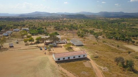 Flying Over a Rural Primary School and Past a Garden in Zimbabwe, Africa