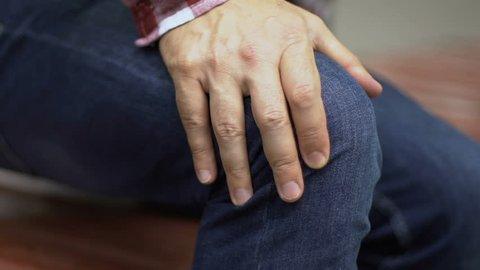 Man feels knee pain while standing up, menisci damage, arthritis illness closeup