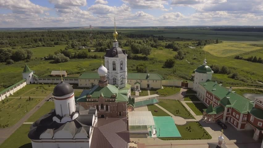 Aerial view of the ancient monastery, the church in the forest,castle,walls,church building.Orthodox Christian monastery. 4K video,ultra HD