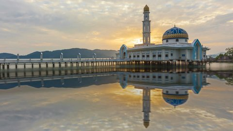 Floating mosque at sunset with reflection from day to night at dusk in an island. Pangkor, Malaysia. Masjid 1000 Selawat. Prores 4K.