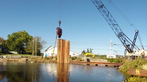 Construction of a cofferdam to keep the water level rising so a new bridge can be built