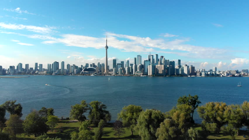 Aerial view of Toronto skyline, Centre Island and Lake Ontario during summer in Toronto, Ontario, Canada. | Shutterstock HD Video #1016874202