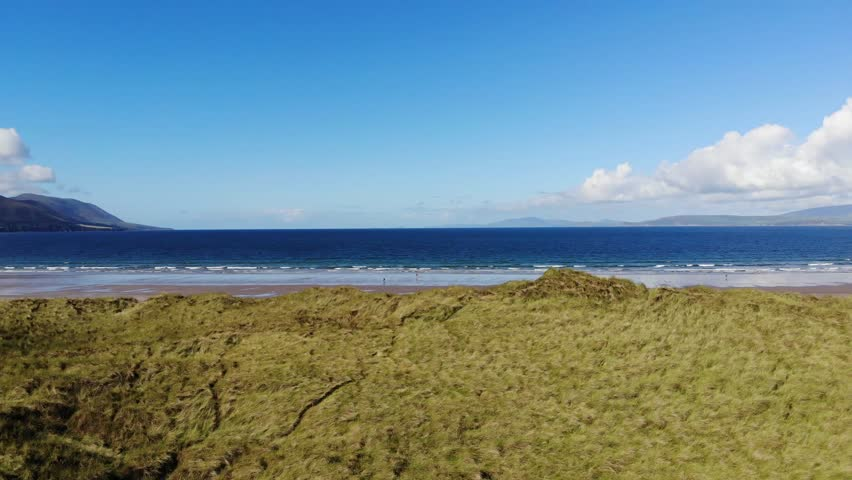 The grassy dunes at the Irish west coast – aerial view | Shutterstock HD Video #1016874562