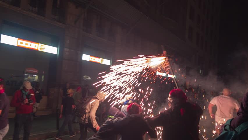 Barcelona, Spain - September 22 2018 : Crowds in the street for the fire run, correfoc during la merce festival. | Shutterstock HD Video #1016886202