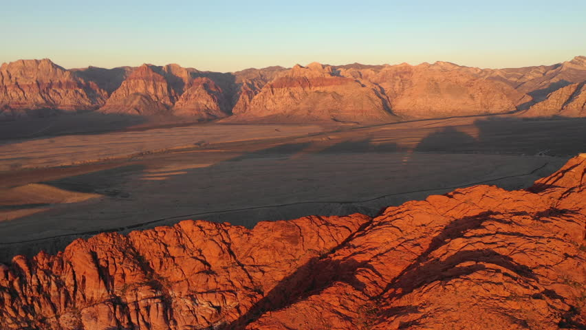 Dawn breaks on colorful mountains in Red Rock Canyon National Conservation Area, located near Las Vegas, NV. Its massive red rock geologic formations are popular for hiking and climbing.   Shutterstock HD Video #1016898412