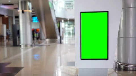 Empty billboard with green screen background in the airport terminal. Shot in 4k resolution