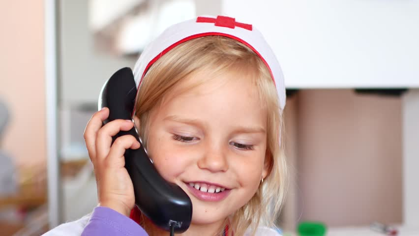 Little girl is playing doctor. Nurse Accepts Call | Shutterstock HD Video #1016954632