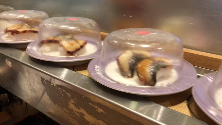 Conveyor belt sushi or rotating sushi in a Sushi restaurant inside a food court restaurant in Kuala Lumpur, Malaysia   Shutterstock HD Video #1016965252