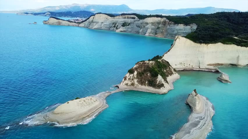 Aerial drone bird's eye view video of iconic white rock volcanic formations with emerald clear water near Canal d' Amour in Sidari area, North Corfu island, Ionian, Greece