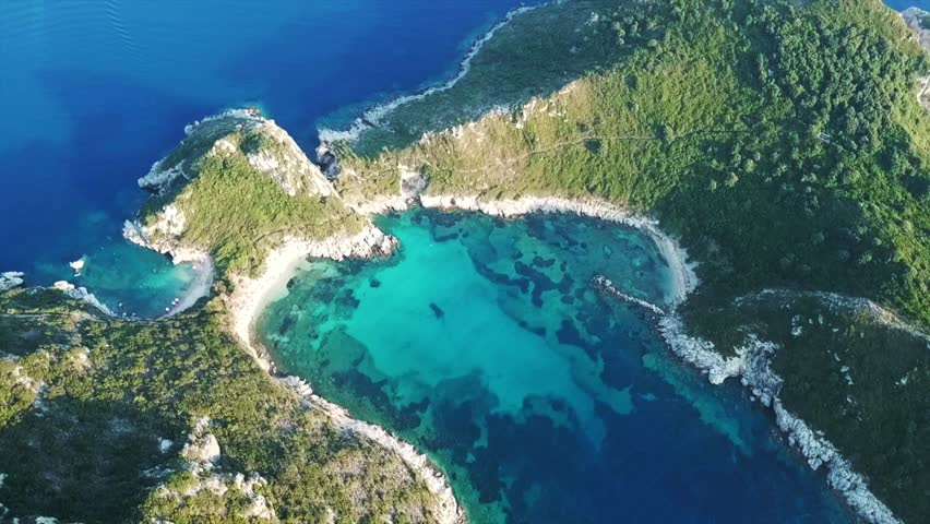 Aerial drone video of iconic paradise bay of Porto Timoni with tropical deep blue and turquoise clear sea, Corfu island, Ionian, Greece