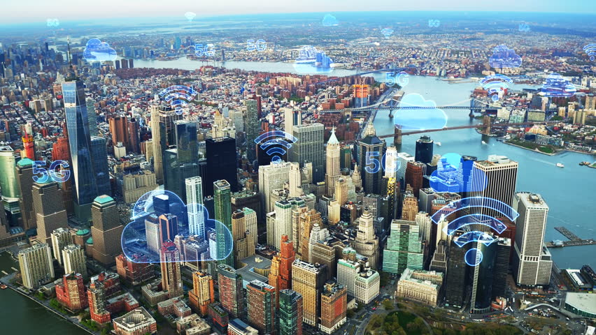 Aerial city connected through 5G. Wireless network, mobile technology concept, data communication, cloud computing, artificial intelligence, internet of things. New York City skyline. Futuristic city. | Shutterstock HD Video #1017009622