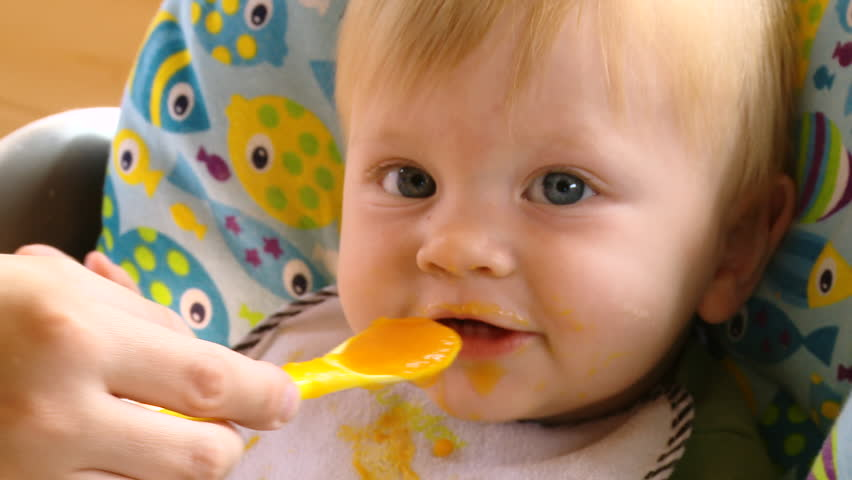 Mother Gives Baby Food-3 | Shutterstock HD Video #1017045922