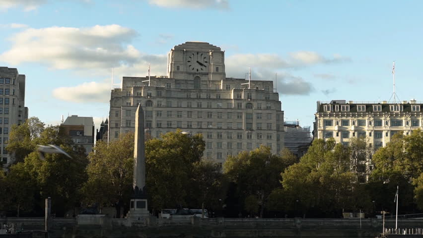 Wide shot of Shell Mex House and Cleopatra's Needle, London, England