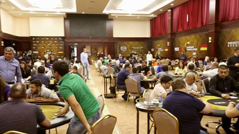 Many poker players in poker tour. Group of professional poker players gather at players table gambling in poker tournament, championship . With sound fx .