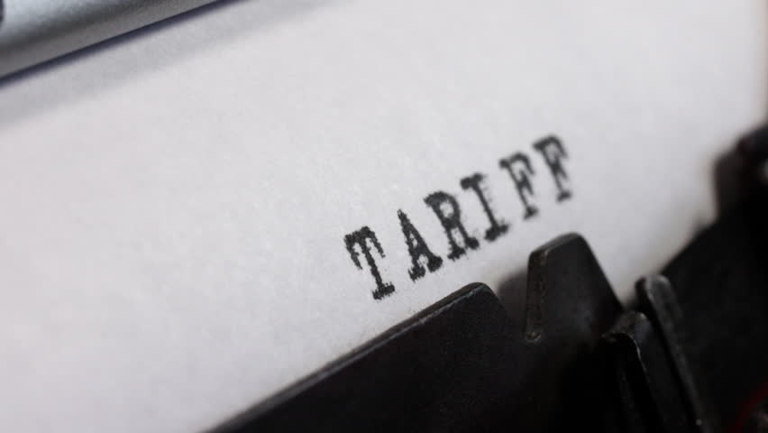 Trade conflict. Tariff War in black ink being typed on an old manual typewriter. | Shutterstock HD Video #1017083362