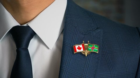 Businessman Walking Towards Camera With Friend Country Flags Pin Canada - Dominica
