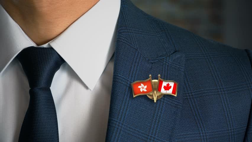 Businessman Walking Towards Camera With Friend Country Flags Pin Hong Kong - Canada | Shutterstock HD Video #1017090022