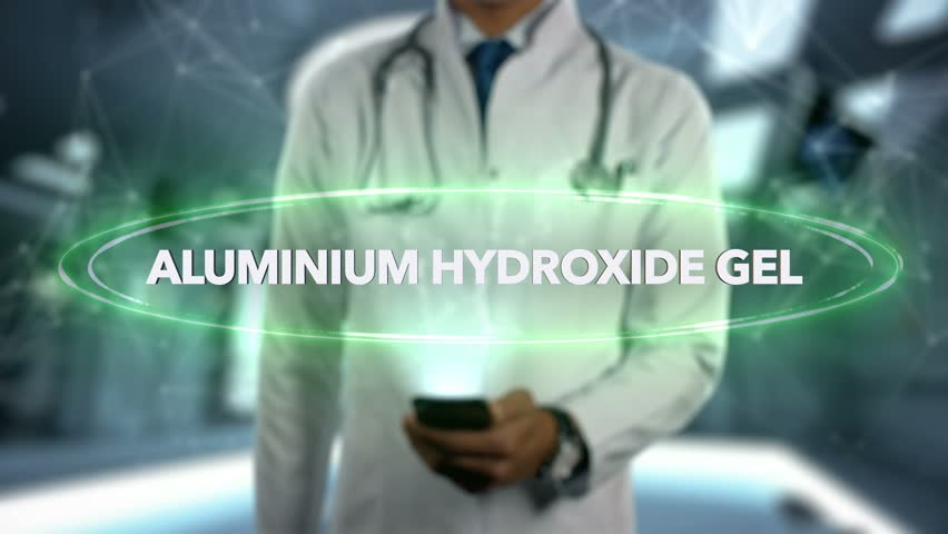 ALUMINIUM HYDROXIDE GEL - Male Doctor With Mobile Phone Opens and Touches Hologram Word Active Ingrident of Medicine