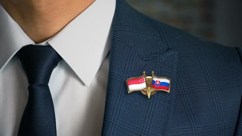 Businessman Walking Towards Camera With Friend Country Flags Pin Singapore - Slovakia